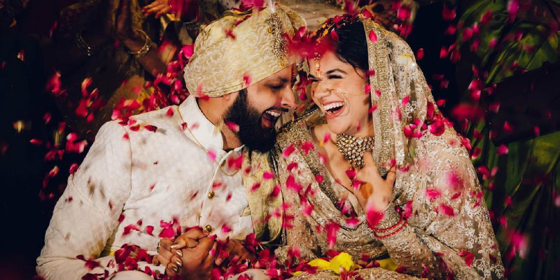 Image That Shows A Beautiful Wedding Couple Smiling with each other in a nature background.