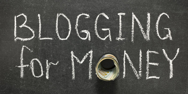 A Text Written That Blogging For Money In A Black Board.